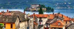 View of the island of San Giulio in Lake Orta on the roofs of Orta
